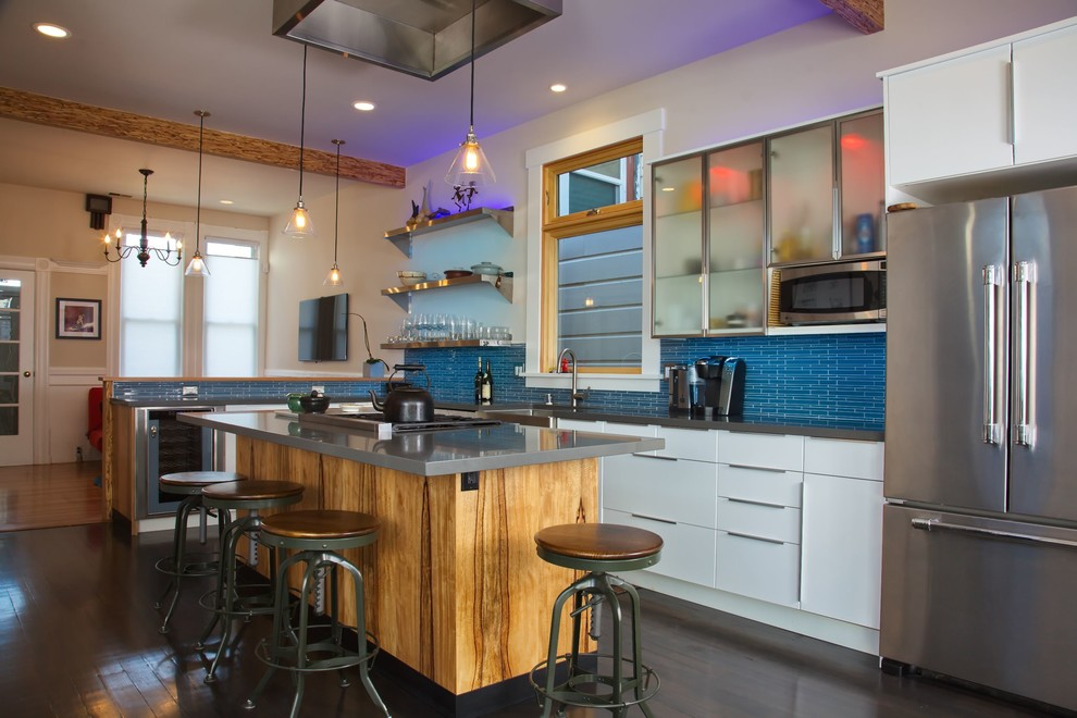 Kitchen - mid-sized contemporary l-shaped brown floor and vinyl floor kitchen idea in San Francisco with white cabinets, blue backsplash, stainless steel appliances, a farmhouse sink, flat-panel cabinets, quartz countertops, glass tile backsplash, an island and gray countertops