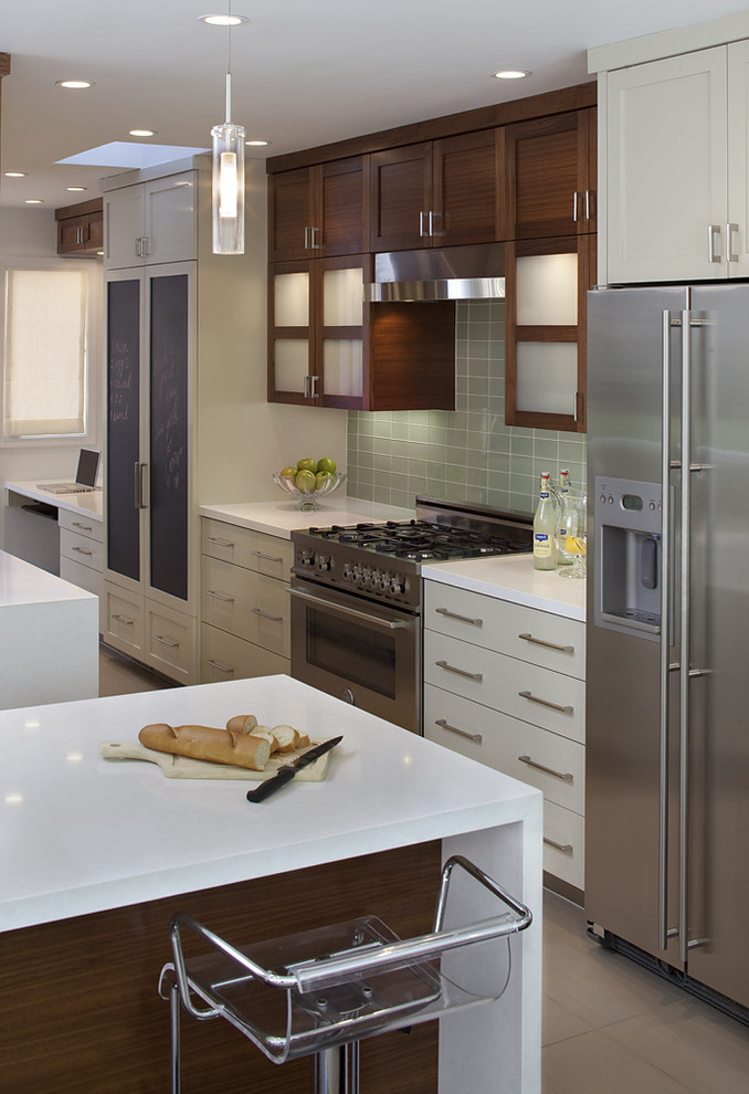 Inspiration for a contemporary kitchen remodel in San Francisco with flat-panel cabinets, beige cabinets, green backsplash and stainless steel appliances