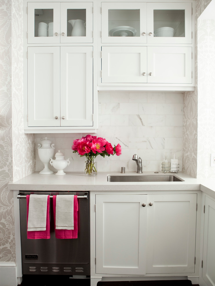 Inspiration for a timeless kitchen remodel in San Francisco with shaker cabinets, stainless steel appliances, a single-bowl sink, white cabinets, white backsplash and stone tile backsplash