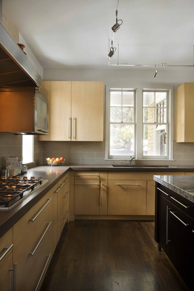 Example of a trendy kitchen design in Boston with flat-panel cabinets, light wood cabinets and quartz countertops