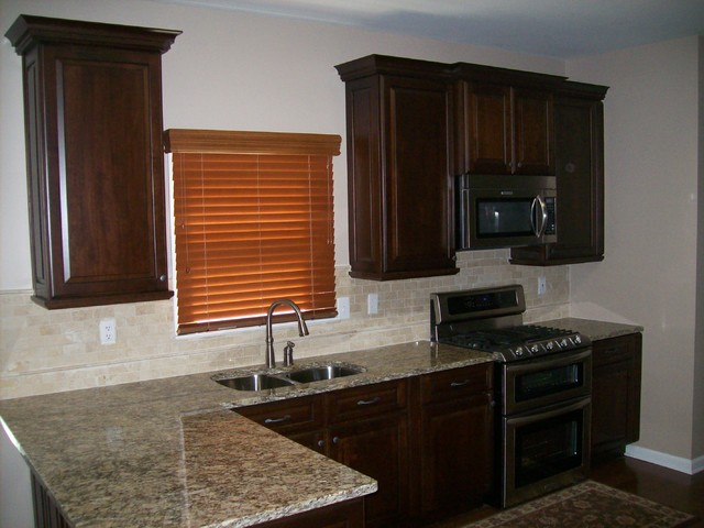 Princeton Cherry Ginger Snap With Ebony Glaze By Schuler Cabinetry traditional-kitchen