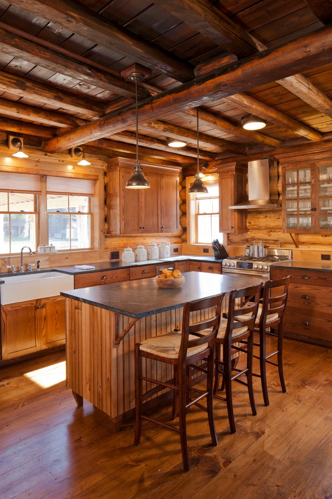 Kitchen - rustic kitchen idea in Portland Maine with a farmhouse sink, flat-panel cabinets and medium tone wood cabinets