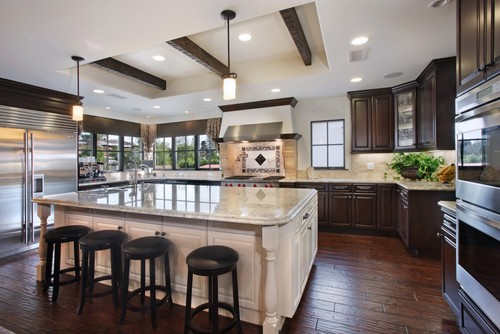 Why different color for island cabinetry for Dark kitchen cabinets with light island