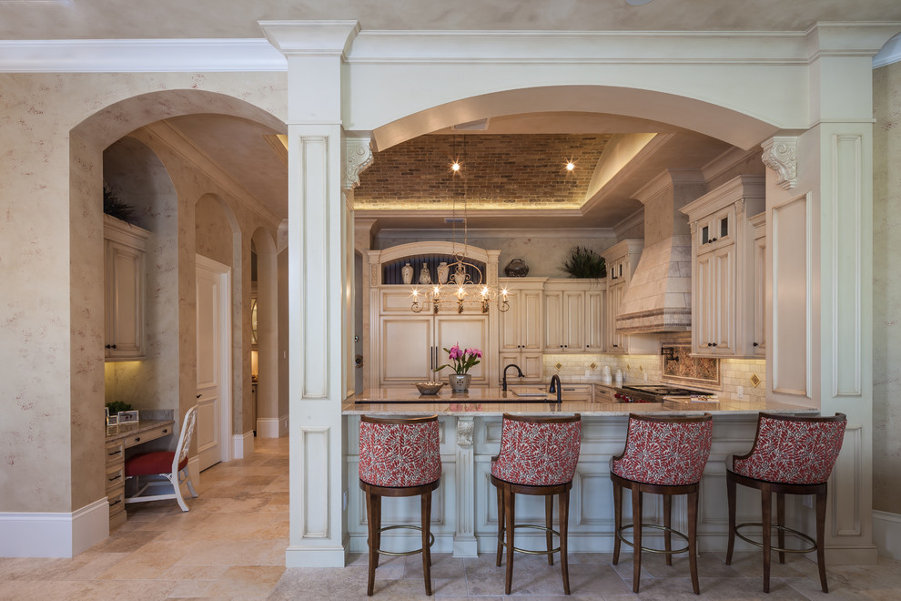 Inspiration for a timeless u-shaped kitchen remodel in Miami with raised-panel cabinets, beige cabinets, beige backsplash and beige countertops