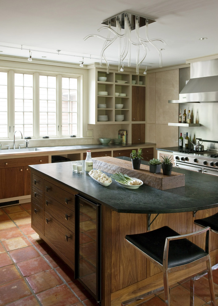 Mountain style kitchen photo in Boston with open cabinets and soapstone countertops