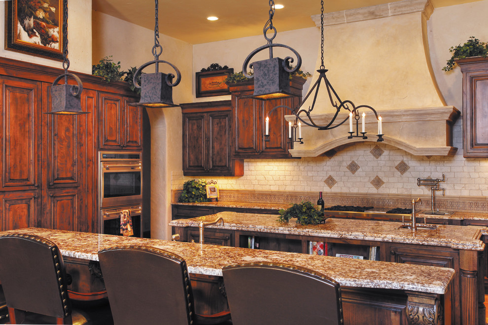 Tuscan kitchen photo in Austin with stainless steel appliances