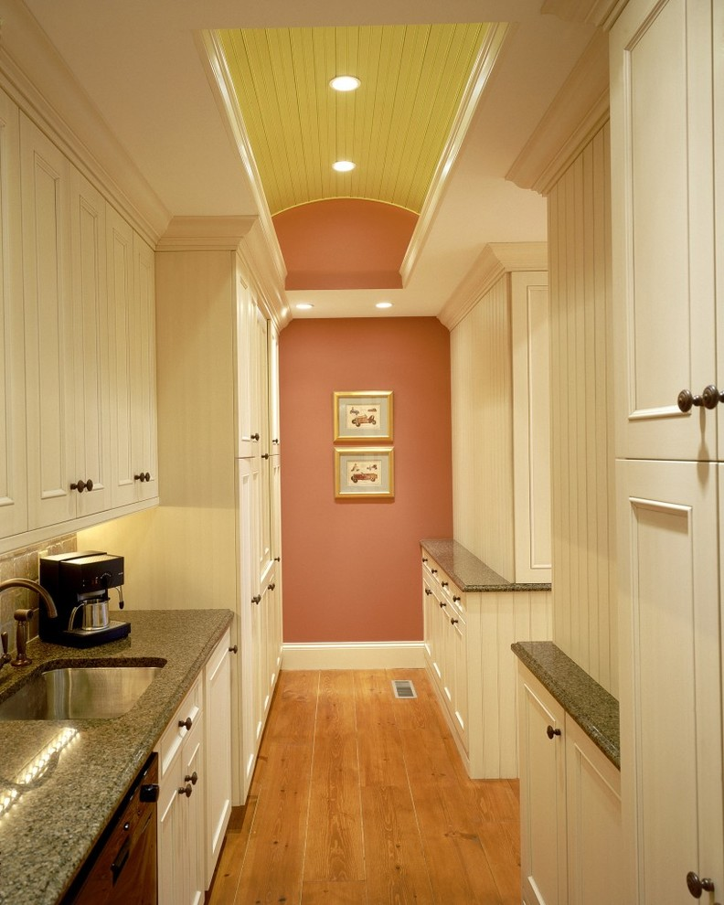 Inspiration for a timeless galley kitchen remodel in Boston with an undermount sink, recessed-panel cabinets, white cabinets and beige backsplash