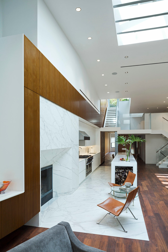 Inspiration for a large contemporary medium tone wood floor kitchen remodel in Los Angeles