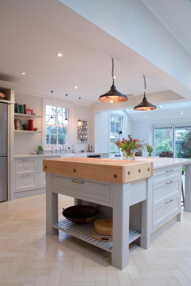 Kitchen - country limestone floor kitchen idea in London
