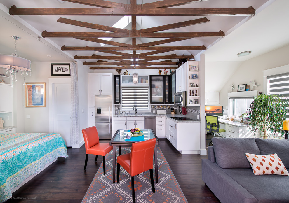 Example of a transitional l-shaped dark wood floor open concept kitchen design in Denver with recessed-panel cabinets, white cabinets, granite countertops, stainless steel appliances, no island, an undermount sink and multicolored backsplash