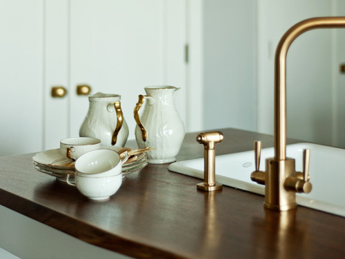 Trend-setting interior design using brushed brass to create a unique, upscale kitchen design.
