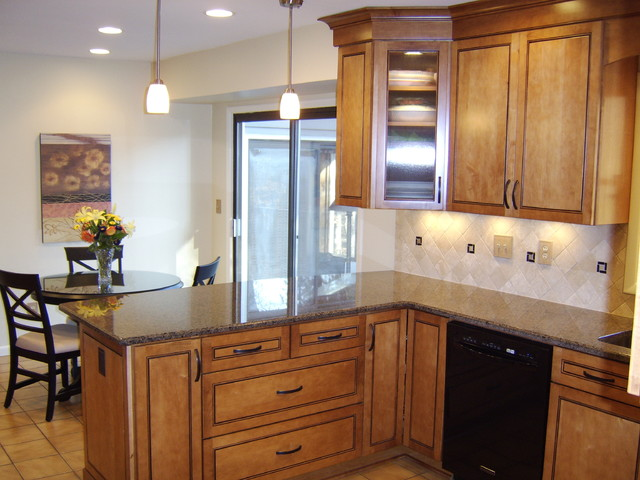 Maple in praline with mocha highlights by kraftmaid for Caldwell kitchen cabinets