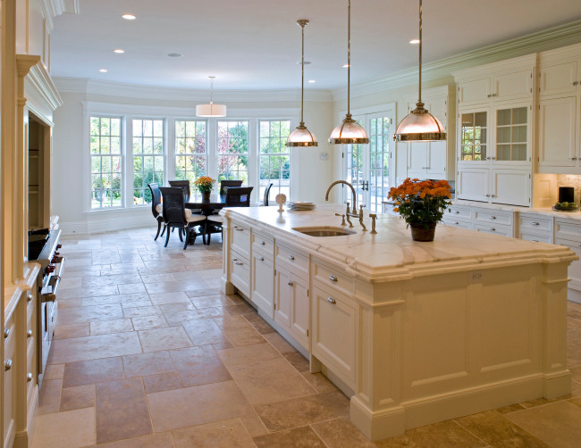 Eat-in kitchen - large traditional galley ceramic tile eat-in kitchen idea in New York with an undermount sink, white cabinets, marble countertops, white backsplash, stainless steel appliances and an island