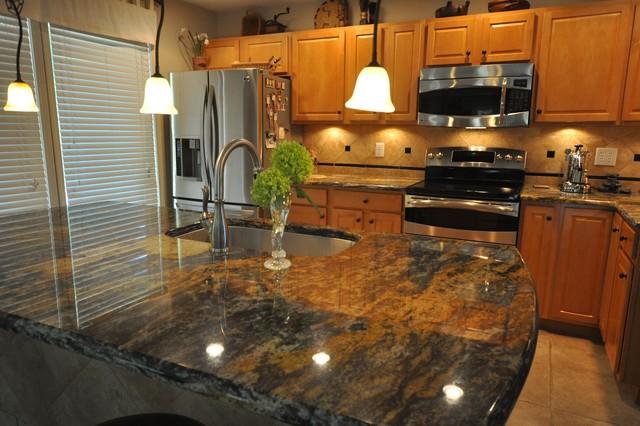 granite countertop with durango tile backsplash traditional kitchen
