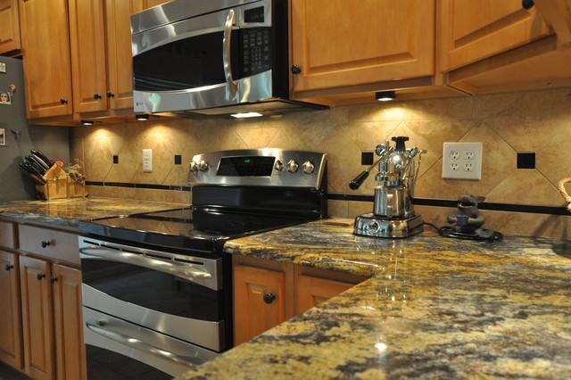 purple dunas granite countertop with durango tile backsplash