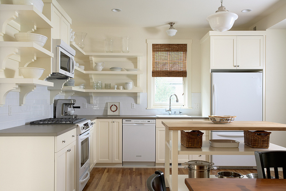 Elegant kitchen photo in Minneapolis with laminate countertops, white appliances and open cabinets