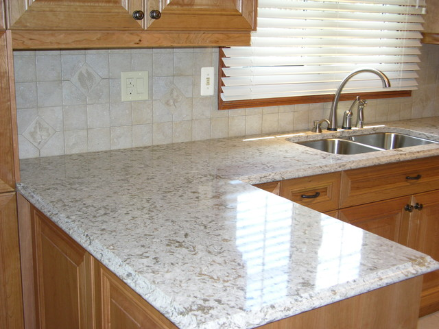 quartz countertop and tiled backsplash