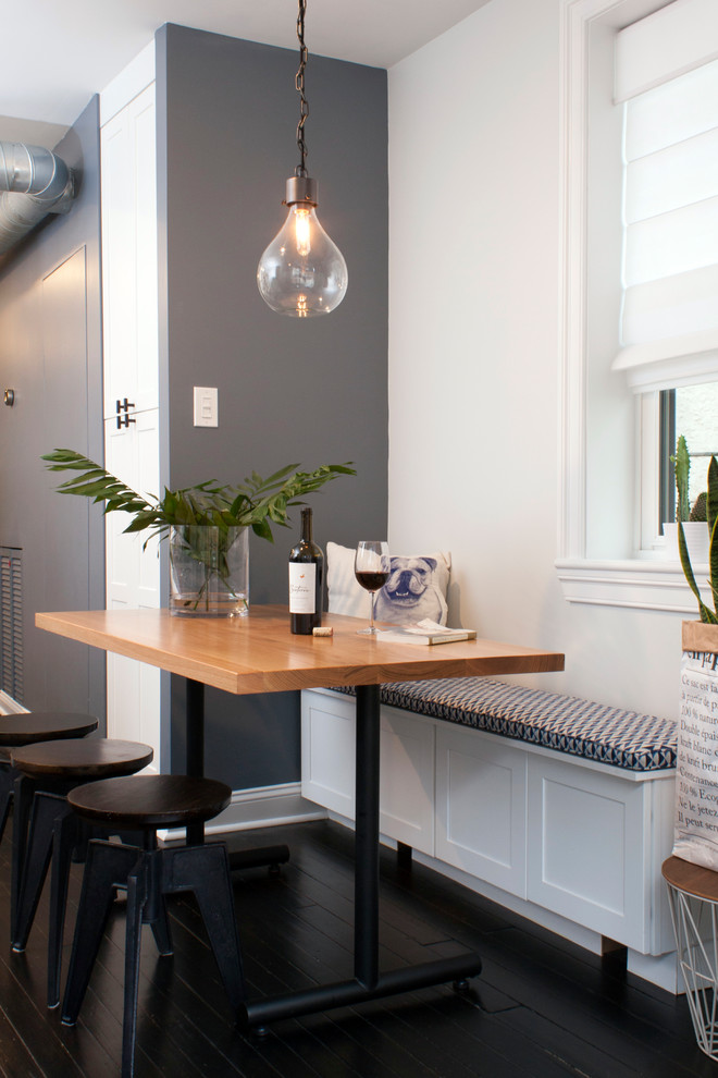 Inspiration for a contemporary u-shaped dark wood floor eat-in kitchen remodel in Philadelphia with a farmhouse sink, recessed-panel cabinets, white cabinets, quartz countertops and stainless steel appliances