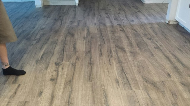 Quickstep Reclaimeu0027 Heathered Oak Laminate Install Beach Style Kitchen