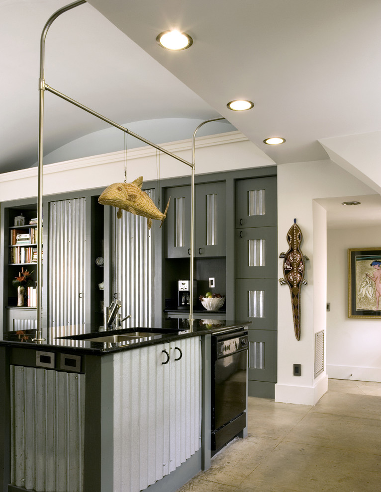 Eat-in kitchen - mid-sized industrial galley concrete floor eat-in kitchen idea in Atlanta with a double-bowl sink, black appliances, stainless steel cabinets, granite countertops and an island
