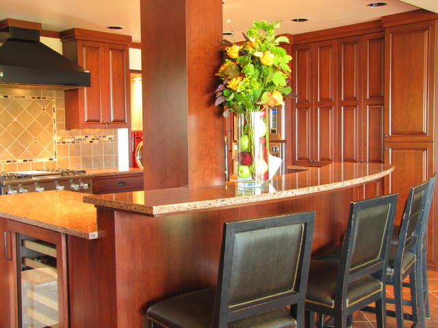 Raised bar seating on curved island traditional kitchen seattle