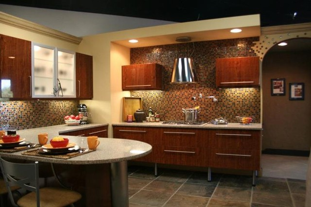 raised kitchen cabinets with stainless legs glass tile splash and