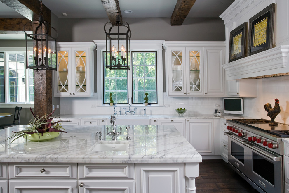 Example of a huge classic u-shaped dark wood floor open concept kitchen design in Chicago with a farmhouse sink, raised-panel cabinets, white cabinets, marble countertops, white backsplash, ceramic backsplash, paneled appliances and an island
