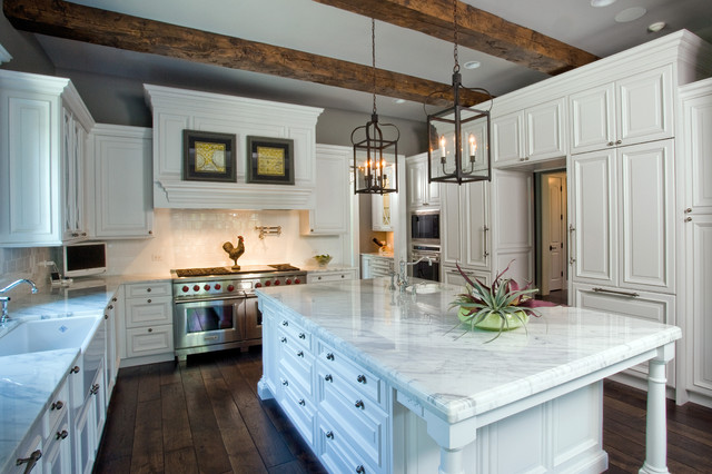 Raised Panel White Cabinet Kitchen With Oversize Island Hand Hewn Ceiling Beam Traditional
