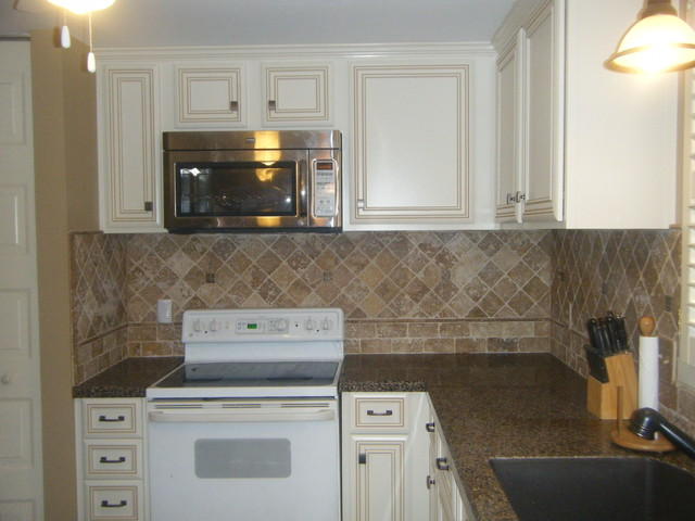 Raising the cabinets and adding crown molding gave the for Adding decorative molding to kitchen cabinets