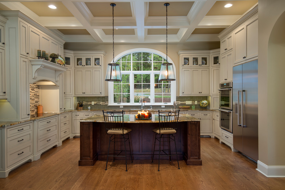 Example of a huge classic u-shaped medium tone wood floor and orange floor eat-in kitchen design in Other with an undermount sink, white cabinets, green backsplash, stainless steel appliances, an island, shaker cabinets, granite countertops, ceramic backsplash and brown countertops