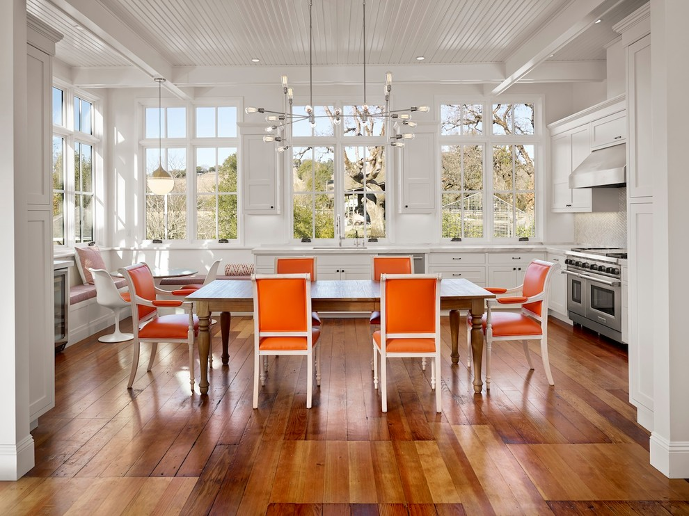 Inspiration for a cottage u-shaped medium tone wood floor eat-in kitchen remodel in San Francisco with white cabinets and stainless steel appliances