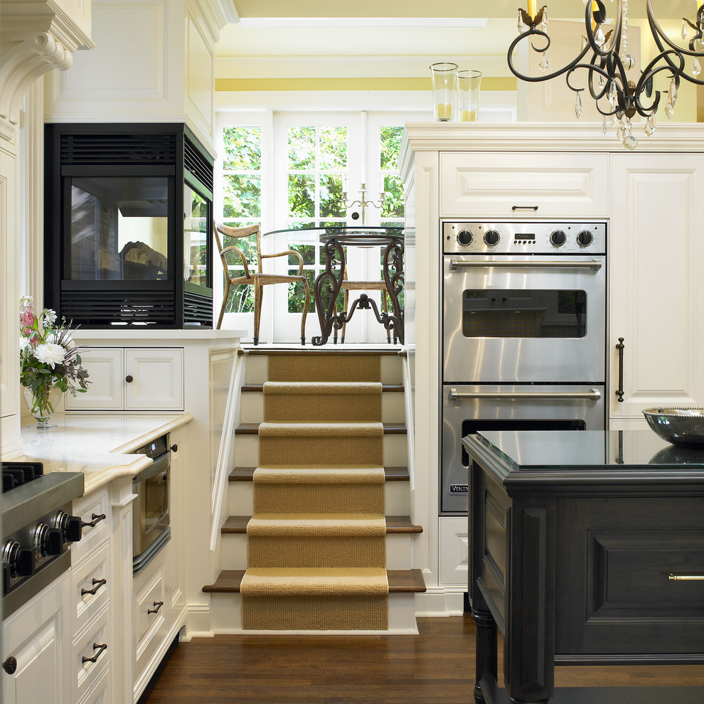 Elegant kitchen photo in Vancouver with stainless steel appliances