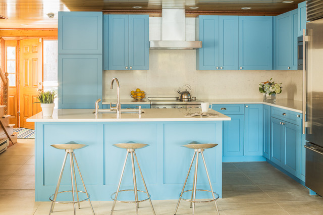 Inspiration for a transitional l-shaped kitchen remodel in Portland Maine with shaker cabinets, blue cabinets, quartz countertops, stainless steel appliances, an island, an undermount sink and beige backsplash