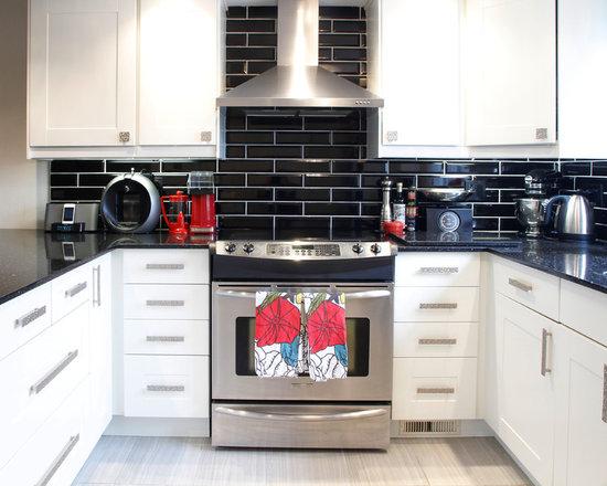 black tile backsplash kitchen design ideas remodels photos