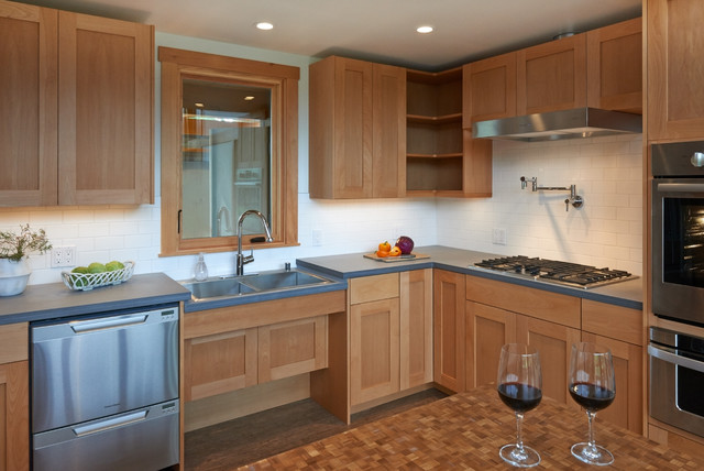 Recessed cabinets under the sink provide plenty of knee space. - Transitional - Kitchen ...
