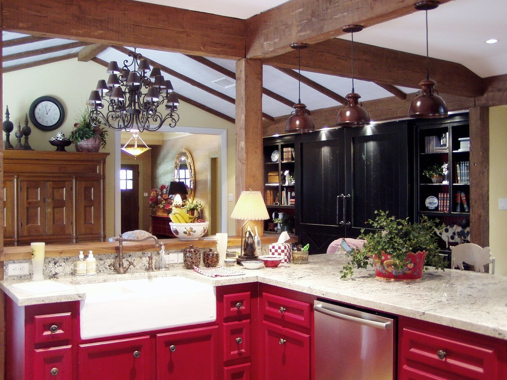 Inspiration for a mid-sized cottage u-shaped medium tone wood floor and brown floor open concept kitchen remodel in Houston with a farmhouse sink, recessed-panel cabinets, red cabinets, marble countertops, beige backsplash, stone slab backsplash and stainless steel appliances