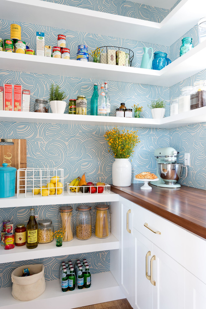 Kitchen pantry - coastal dark wood floor kitchen pantry idea in Los Angeles with shaker cabinets, white cabinets and blue backsplash