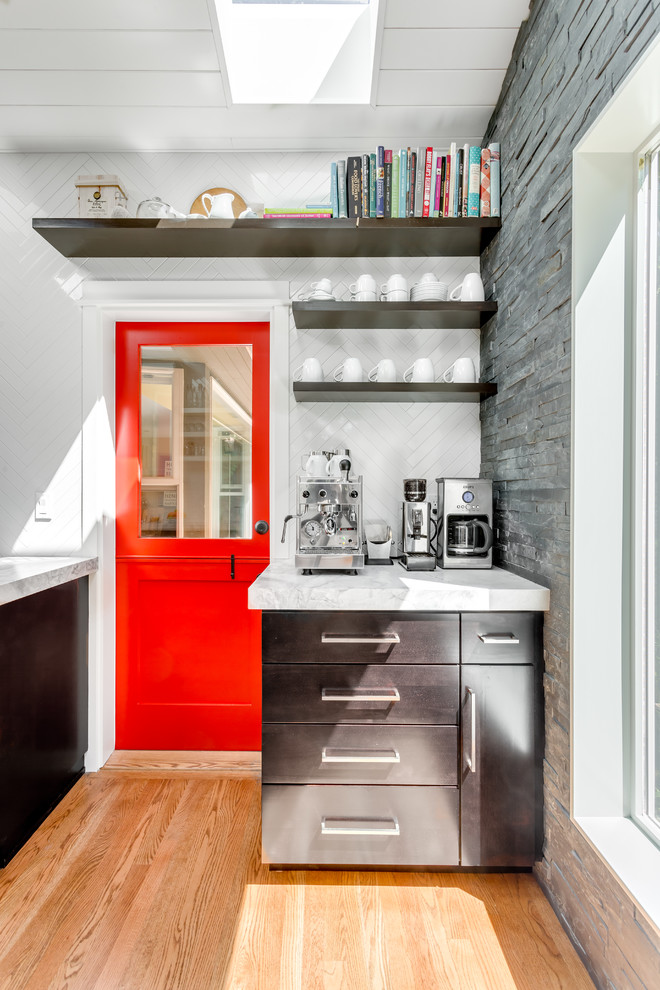 Example of a transitional medium tone wood floor kitchen design in Seattle with open cabinets, dark wood cabinets, white backsplash and quartzite countertops