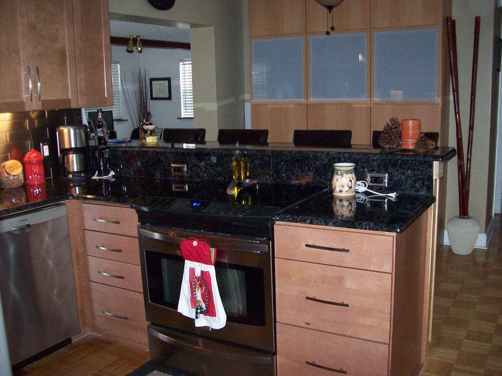 Remodeled kitchen with stainless steel backsplash and ... on Modern Kitchen Backsplash With Maple Cabinets  id=97675