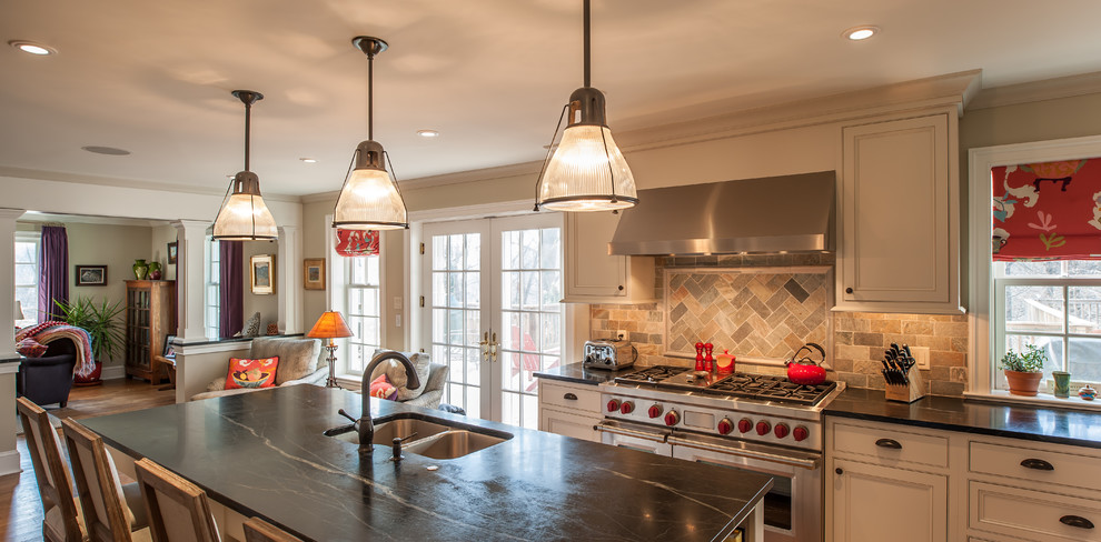 Inspiration for a timeless l-shaped open concept kitchen remodel in Philadelphia with an undermount sink, flat-panel cabinets, white cabinets, multicolored backsplash, stone tile backsplash and stainless steel appliances