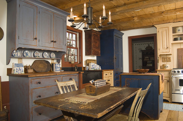 Inspiration for a rustic kitchen remodel in Cincinnati with wood countertops and distressed cabinets