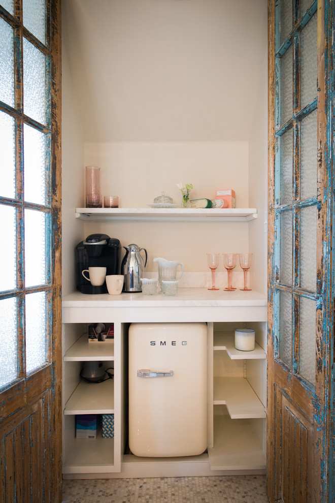 Example of a small cottage chic kitchen design in Philadelphia with open cabinets, white cabinets and white appliances