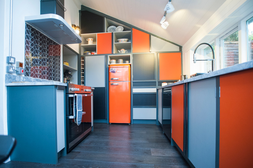 Kitchen - mid-sized eclectic u-shaped kitchen idea in Cornwall with orange cabinets