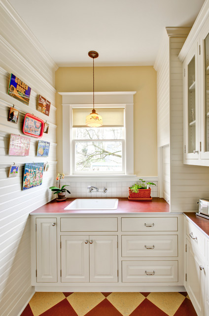Inspiration for a timeless enclosed kitchen remodel in Portland with raised-panel cabinets, white cabinets, laminate countertops, white backsplash and a drop-in sink