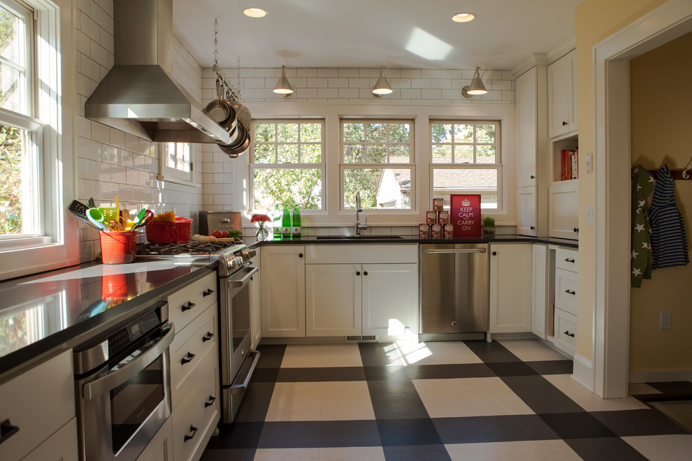 Inspiration for a timeless multicolored floor kitchen remodel in Minneapolis with stainless steel appliances, white cabinets, quartz countertops, white backsplash and subway tile backsplash