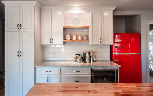 Fun retro kitchens - I love this colorful orange-red refrigerator