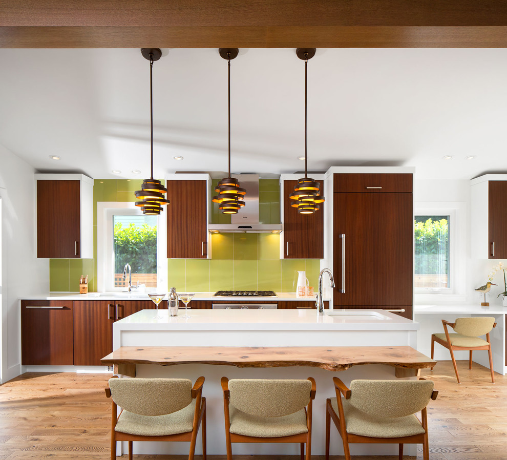 Inspiration for a 1960s single-wall open concept kitchen remodel in Vancouver with an undermount sink, brown cabinets, quartz countertops, green backsplash, terra-cotta backsplash and paneled appliances