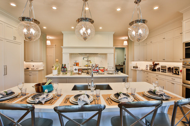Open concept kitchen - large transitional u-shaped light wood floor open concept kitchen idea in Salt Lake City with an undermount sink, shaker cabinets, white cabinets, quartzite countertops, white backsplash, subway tile backsplash, stainless steel appliances and two islands