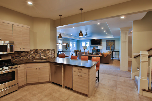 Inspiration for a large transitional u-shaped porcelain floor open concept kitchen remodel in Salt Lake City with an undermount sink, flat-panel cabinets, gray cabinets, multicolored backsplash, matchstick tile backsplash, stainless steel appliances, a peninsula and quartzite countertops