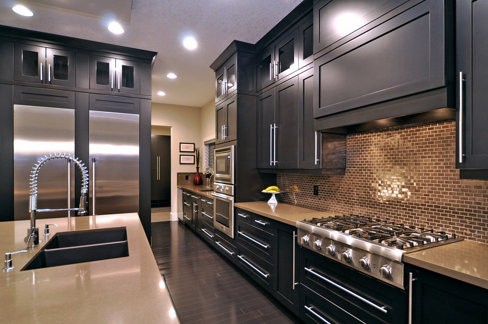 Inspiration for a contemporary kitchen remodel in Calgary with stainless steel appliances, a double-bowl sink, black cabinets, metallic backsplash and metal backsplash